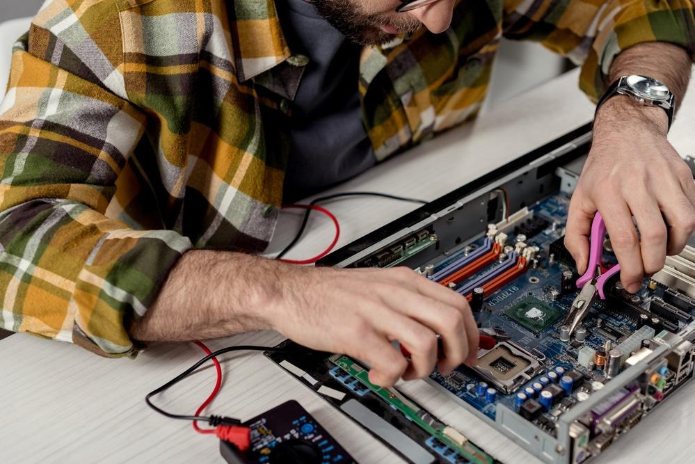person testing electronics