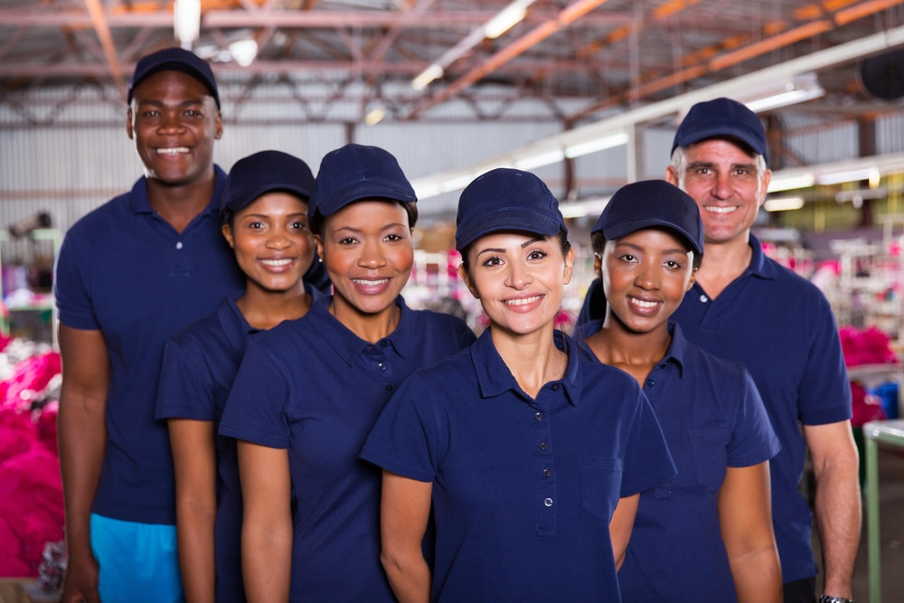 group of happy clothing factory workers
