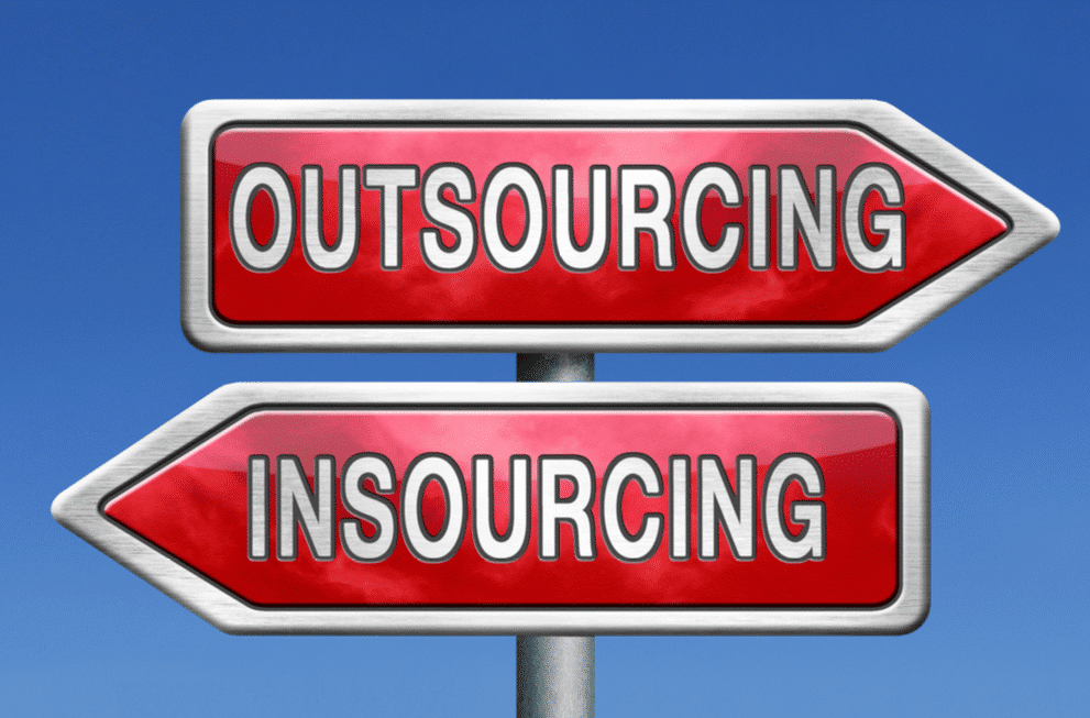 signs that say outsourcing and insourcing
